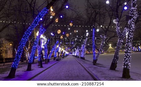 MOSCOW - JANUARY 03, 2014: Chistoprudniy boulevard (Chistiye prudi) illuminated for Christmas and New Year holidays. - stock photo