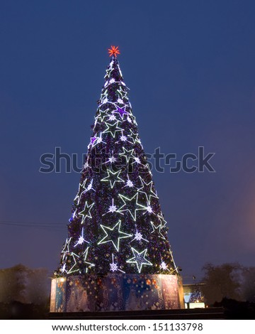 """MOSCOW - JANUARY 06: Christmas - New year tree on Pushkinskaya square - cultural centre of the city, near cinema """"Russia"""", January 06, 2013, in town Moscow, Russia. - stock photo"""