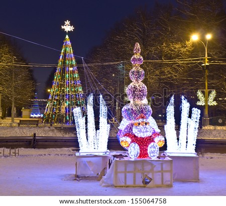MOSCOW - JANUARY 03: Christmas tree and electric sculpture of Santa Claus, recorded in park Sokolniki, January 03, 2012 in Moscow. - stock photo