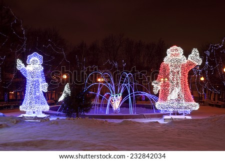 MOSCOW - JANUARY 12, 2014: electric sculpture of deer and Christmas, New Year tree, street decoration to Christmas and New Year holidays on Pushkinskaya square. Moscow, Russia. - stock photo