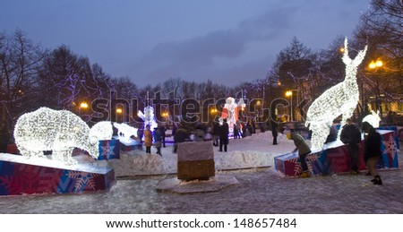 MOSCOW - JANUARY 06: electric sculptures of deer, bear and other animals, Santa Claus and Snowgirl on Pushkinskaya square for Christmas and New year holidays, January 06, 2013, in town Moscow, Russia. - stock photo