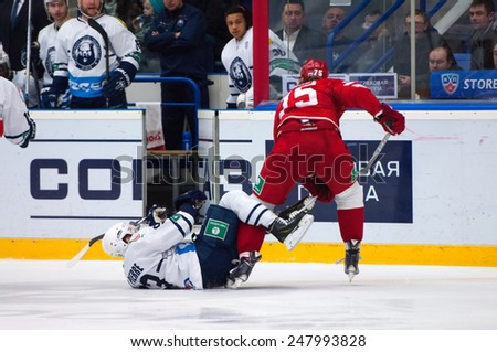 MOSCOW - JANUARY 10: M. Yakubov (75) and M. Pierre (93) in action on hockey game Vityaz vs Medvezchak on Russian KHL premier hockey league Championship on January 10, 2015, in Moscow, Russia - stock photo