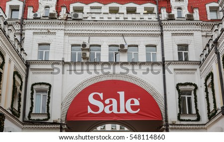 MOSCOW - 2 JANUARY,2017: New Year celebration in capital of Russia.Winter sale season in shops.Big red and white sale banner on store building