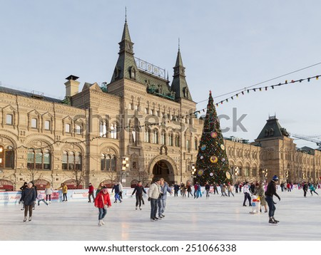 Moscow - January 16, 2015: People skate on the rink for the Christmas holidays on the Red Square and decorated Christmas tree Jan. 16, 2015, Moscow, Russia - stock photo