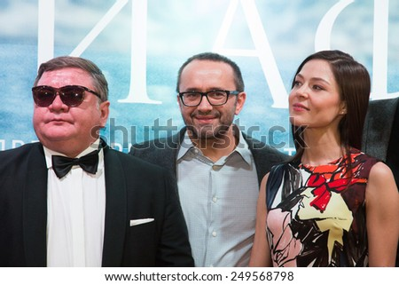 MOSCOW - JANUARY, 28: R. Medyanov, A. Zvyagintsev, E. Lyadova. Premiere of the movie Leviathan at Moscow Cinema,  January, 28, 2015 in Moscow, Russia - stock photo