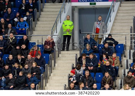 MOSCOW - JANUARY 29, 2016: Unidentified people on tribunes during hockey game Sweden vs Czech on League of World legends of Ice hockey championship in VTB ice arena, Russia. Czech won 8:2 - stock photo