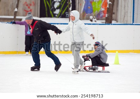 MOSCOW - JANUARY 25: Unidentified people run with sledge on family sport event on January 25, 2015 in Moscow, Russia