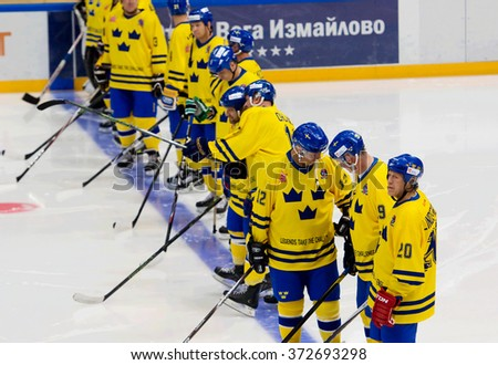MOSCOW - JANUARY 29, 2016: Unidentified players of Sweden team just before hockey game Sweden vs Czech on League of World legends of Ice hockey championship in VTB ice arena, Russia. Czech won 8:2 - stock photo