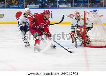 MOSCOW - JANUARY 10: V. Soloduhin (17) in action on hockey game Vityaz vs Medvezchak on Russian KHL premier hockey league Championship on January 10, 2015, in Moscow, Russia. Medvezcak won 3:2 - stock photo