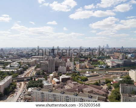 Moscow - 25 July 2015: Aerial view of the city in the summer and see the skyscrapers of Moscow City and the streets of the city and the movement of vehicles 25 June 2015, Moscow, Russia