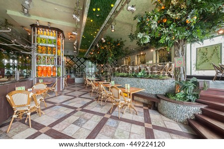 "MOSCOW - JULY 2014: Chain home cooking restaurant ""GRABLI"". The interior of the concept of landscape gardening style. Rack with decorative fruits and vegetables in jars"