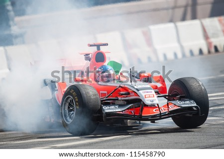 MOSCOW - JULY 15: Charles Pic of Marussia F1 Racing at Moscow City Racing 2012 at Kremlin embankment July 15, 2012 in Moscow