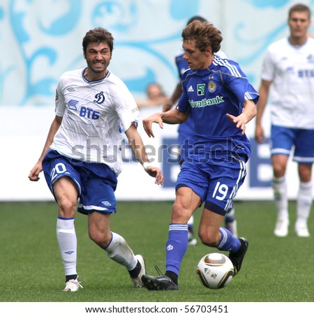 MOSCOW - JULY 3: Dynamo Moscow's midfielder Adrian Ropotann (L) and Dynamo Kyiv's midfielder Denis Garmash (R) in the game Dynamo Moscow vs. Dynamo Kyiv (2:0), July 3, 2010 in Moscow, Russia.
