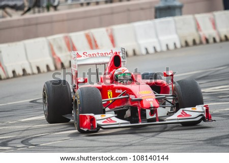 MOSCOW - JULY 15: Giancarlo Fisichella of Scuderia Ferrari at Moscow City Racing 2012 at Kremlin embankment July 15, 2012 in Moscow - stock photo