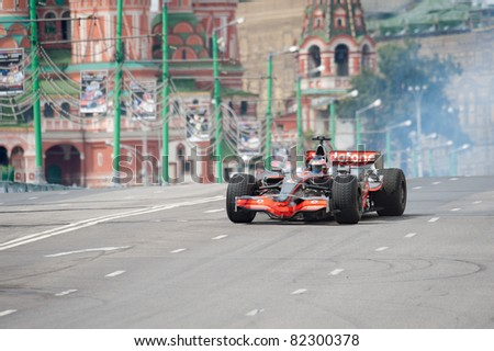 MOSCOW - JULY 17: Jenson Button of McLaren Mercedes at Bavaria Moscow City Racing 2011 at Kremlin embankment July 17, 2011 in Moscow. - stock photo