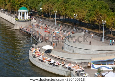 MOSCOW - JULY 31: Many people resting at Olive Beach in Gorky Park on July 31, 2014 in Moscow. Olive Beach is located on the bank of Moskva River. - stock photo