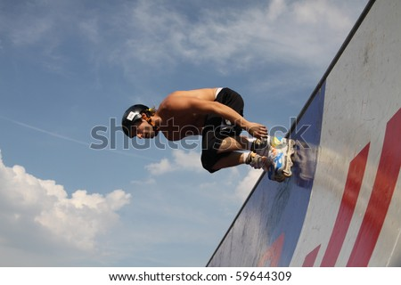MOSCOW - JULY 31: Marco de Santi (Brazil) performs a jump in Luzhniki Olympic Arena on July 31, 2010 in Moscow, Russia. - stock photo