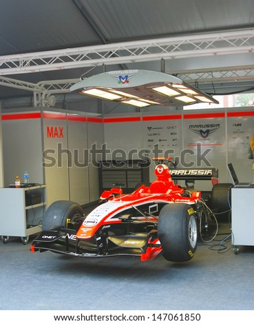 MOSCOW - JULY 20: Marussia F1 sport car at Moscow City Racing. Formula 1 teams show in historical city center of Moscow. Taken on July 20, 2013 in Moscow, Russia.  - stock photo