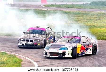 MOSCOW - JULY 6: Nikita Shikov's Mitsubishi FTO competes at the Drift show at the annual International Motor show Autoexotica on July 6, 2012 in Moscow, Russia.