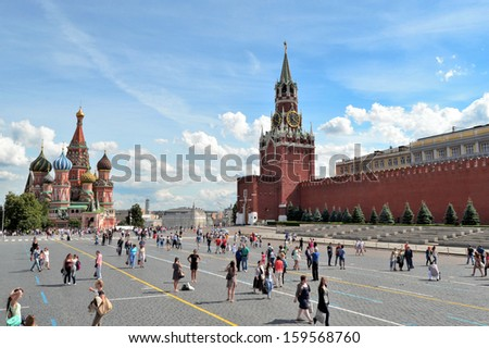 MOSCOW - JULY 18:Panorama of Red Square in Moscow, Spasskaya clock tower and Saint Basil's Cathedral, Moscow. Popular touristic landmark. Taken on July 18, 2013 in Moscow, Russia - stock photo