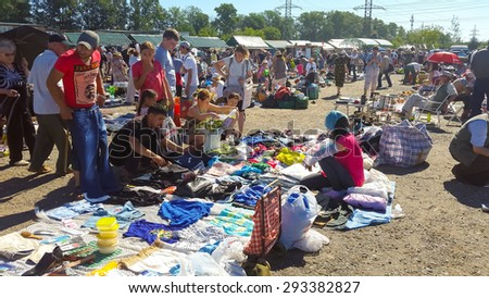 "MOSCOW - JULY 04: People buy and sell used items at a flea market ""Levsha"" at Novopodrezkovo on July,4 2015 in Moscow."