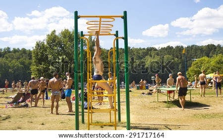 MOSCOW - JULY 20, 2014: people ingage in sports on beach in Serebryany bor (Silver forest) on Moskva-river, one of the most popular beaches of the city. - stock photo