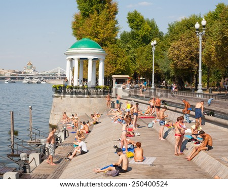 MOSCOW - JULY 31: People relaxing at Olive Beach on Moscow River on July 31, 2014 in Moscow. Olive Beach is located in Gorky Park. - stock photo