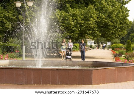 MOSCOW - JULY 15, 2014: people rest in rosarium in park Sokolniki, park founded in 1878 in hunting area of Russian kings near Moscow. - stock photo