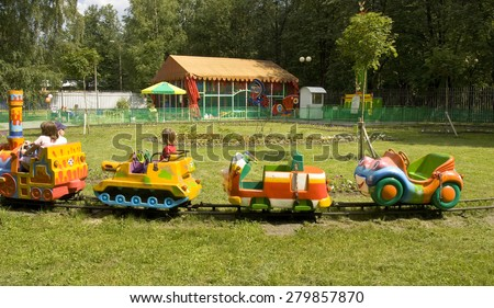 MOSCOW - JULY 01, 2014: people rest on attractions in Izmaylovsky park - the biggest park in Europe. - stock photo