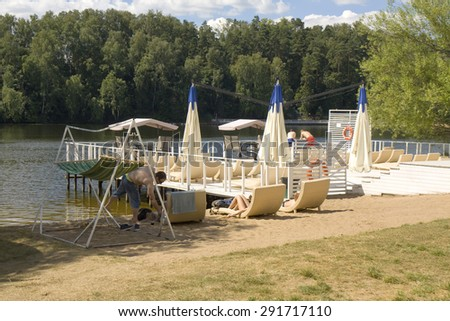 MOSCOW - JULY 20, 2014: people rest on beach in Serebryany bor (Silver forest) on Moskva-river, one of the most popular beaches of the city.