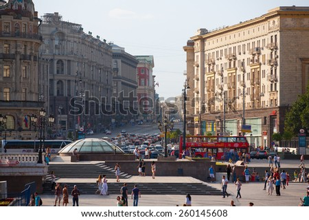 MOSCOW - JULY 29: People walking on Manezh Square on July 29, 2014 in Moscow. Tverskaya Street is in the background. - stock photo