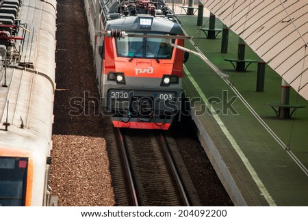 MOSCOW - JULY 9: Russian Railways electric train in Ramenskoye - suburb of Moscow on July 9, 2014. Route Golutvin - Ramenskoye - Moscow. - stock photo