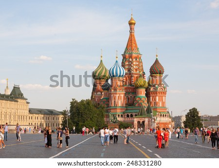 MOSCOW - JULY 29: St. Basil's Cathedral and walking people on Red Square on July 29, 2014 in Moscow. - stock photo