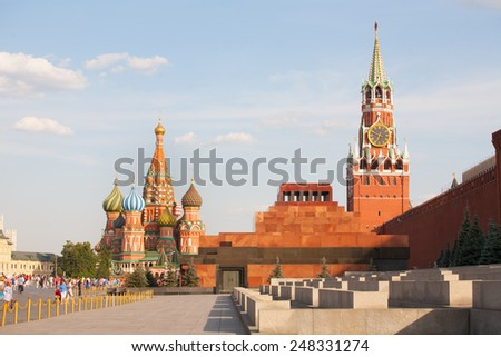MOSCOW - JULY 29: St. Basil's Cathedral, Lenin's Mausoleum, Spasskaya Tower and walking people on Red Square on July 29, 2014 in Moscow. - stock photo