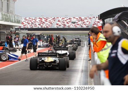 MOSCOW - JULY 13: View of Renault Formula 2.0 cars racing at the Moscow Raceway circuit on July 13, 2012 in Moscow, Russia.The first events held at the circuit were part of the World Series by Renault - stock photo