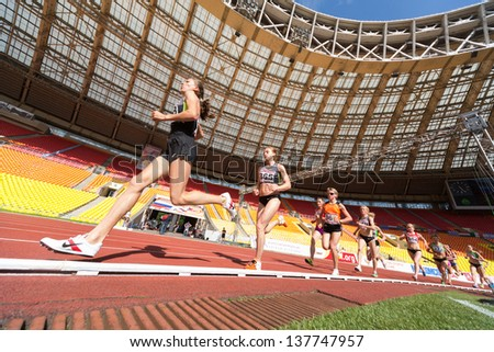 MOSCOW - JUN 11: Female athlete running in the stadium on International athletic competition Moscow Challenge on June 11, 2012 in Luzhniki, Moscow, Russia