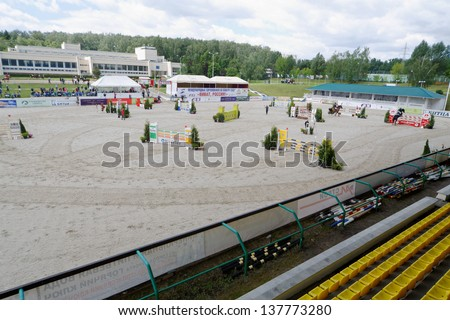 MOSCOW - JUN 9: International competitions in show jumping CSI3 Vivat, Russia in equestrian center Bitsa, June 9, 2012, Moscow, Russia. This is one of most important events of Russian summer season. - stock photo