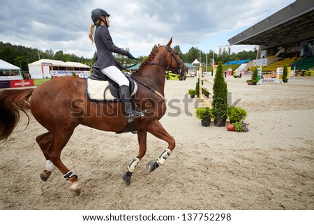 MOSCOW - JUN 9: Rider on horse at competitions in show jumping CSI3 Vivat, Russia in equestrian center Bitsa, June 9, 2012, Moscow, Russia. Prize fund of competition was 114 500 euros. - stock photo