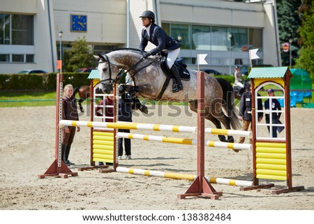 MOSCOW - JUN 9: Rider on horse at international competitions in show jumping CSI3 Vivat, Russia in equestrian center Bitsa, Jun 9, 2012, Moscow, Russia. 178 pairs sent applications for participation. - stock photo
