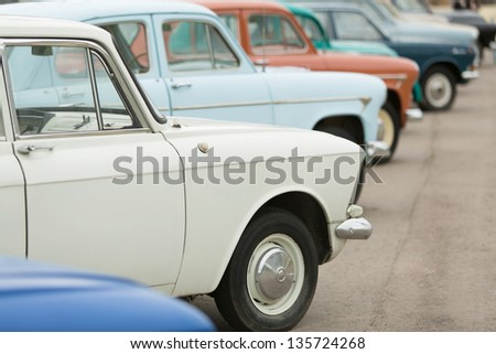 MOSCOW - JUN 8: Side view on the cars in Exhibition of Soviet vintage cars near the Ostankino TV tower on June 8, 2012 in Moscow, Russia. - stock photo