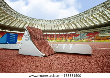 MOSCOW - JUN 11: Starting blocks on race track for steeplechase at Grand Sports Arena of Luzhniki OC at athletics competitions IAAF World Challenge Moscow Challenge, June 11, 2012, Moscow, Russia. - stock photo
