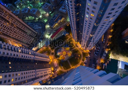 MOSCOW - JUN 12, 2016: Yard with cars and playground near dwelling complex Sparrow Hills at night. Aerial view