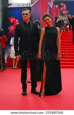 MOSCOW - JUNE 19, 2015: Actor Egor Beroev and actress Ksenia Alferova at XXXVII Moscow International Film Festival red carpet opening ceremony.