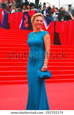 MOSCOW - JUNE 19, 2015: Actress Alla Dovlatova at XXXVII Moscow International Film Festival red carpet opening ceremony. - stock photo