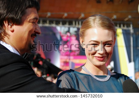 MOSCOW - JUNE 20: Actress Oksana Akinshina gives interview to a journalist Ildar Zhindarev at XXXV Moscow International Film Festival red carpet opening ceremony. Taken on June 20, 2013 in Moscow.