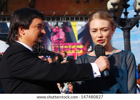 MOSCOW - JUNE 20: Actress Oksana Akinshina gives interview to tv host Ildar Zhindarev at XXXV Moscow International Film Festival red carpet opening ceremony. Taken on June 20, 2013 in Moscow, Russia.