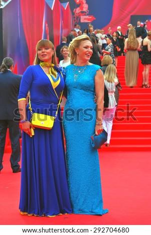 MOSCOW - JUNE 19, 2015: Actresses Natalia Gromushkina and Alla Dovlatova at XXXVII Moscow International Film Festival red carpet opening ceremony. - stock photo