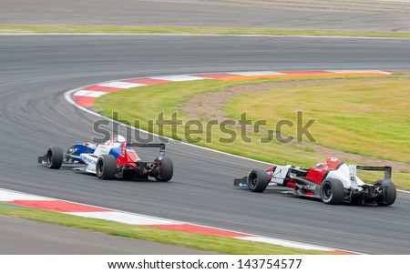 MOSCOW - JUNE 23: Egor Orudzhev (left) of Tech 1 R team (FRA) and Hans Willemi (right) of Atech Reid Team (GBR) races at World Series by Renault in Moscow Raceway on June 23, 2013 in Moscow