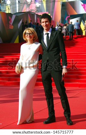 MOSCOW - JUNE 20: Fashion expert, tv-presenter Evelina Khromchenko with her son at XXXV Moscow International Film Festival red carpet opening ceremony. Taken on June 20, 2013 in Moscow, Russia.