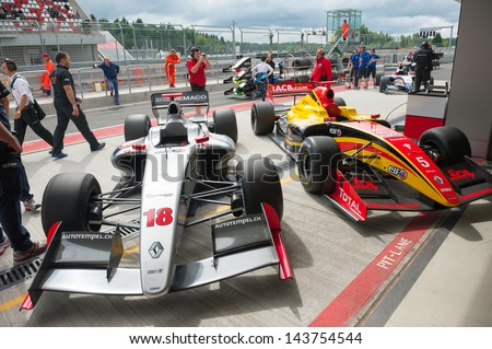 MOSCOW - JUNE 23: Formula cars show at pit lane at World Series by Renault in Moscow Raceway on June 23, 2013 in Moscow - stock photo